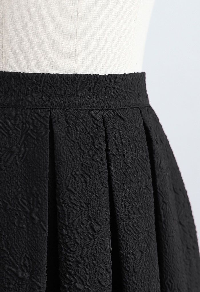 Carnation Embossed Satin Pleated Midi Skirt in Black