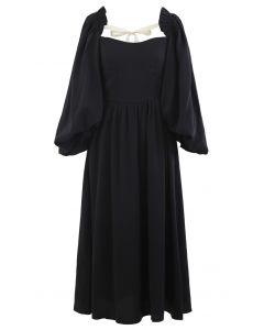 Dramatic Puff Sleeve Shirred Dress in Black